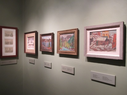 There are five frames hanging on a wall. The first contains three sketches by Dr. Banting and the other four are paintings of his. They all include natural landscapes.